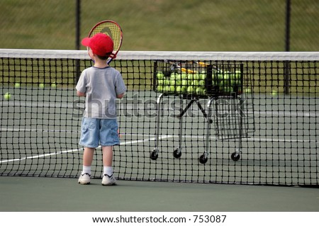 Boy practicing tennis