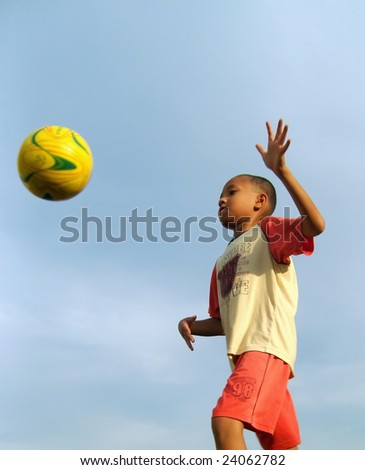 Boy prepares to catch the ball