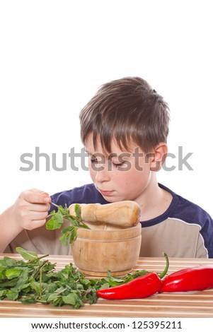 Boy preparing breakfast on a white background - stock photo