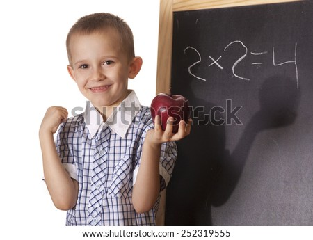 Boy preschooler standing at the blackboard with Apple in hand as Newton. - stock photo