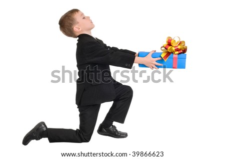 boy presenting a gift for his little love - stock photo