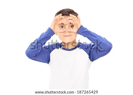 Boy pretending to be looking through binoculars isolated on white background - stock photo