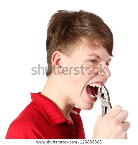 boy pulled himself  teeth with pliers against white background - stock photo