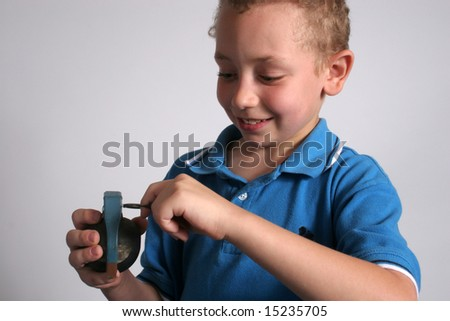 Boy pulling the pin of a handgrenade