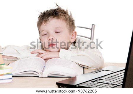 boy pupil sleeps for in time  homework - stock photo