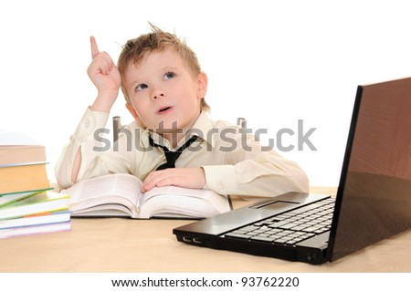 boy pupil thinks for in time  homework - stock photo