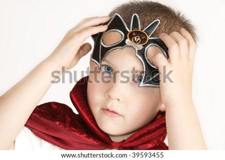boy putting mask on - stock photo