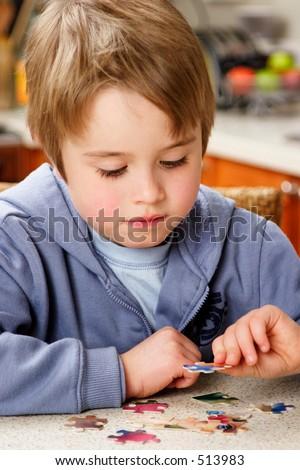 Boy puzzle - stock photo