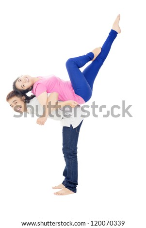Boy raising his girlfriend on his back
