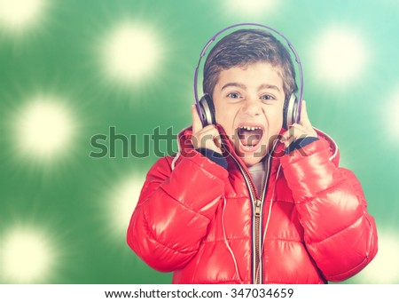 Boy reacts while listening to music. Cross processed image - stock photo