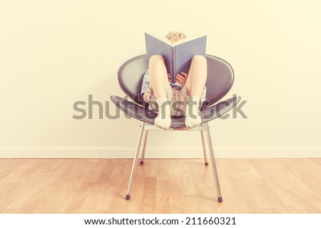 Boy reading a book - stock photo