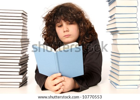 boy reading a book and many books on white background - stock photo