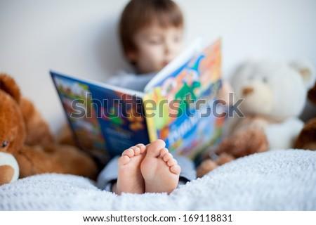 Boy, reading a book, educating - stock photo