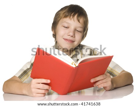 Boy reading a red book - stock photo