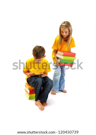 Boy reading an e-book, and a girl keep a few books - stock photo