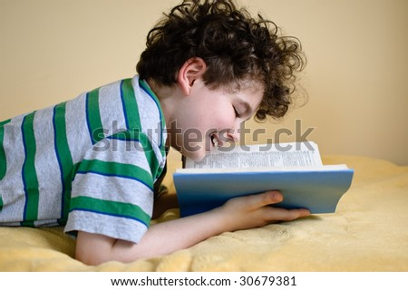 Boy reading book at home