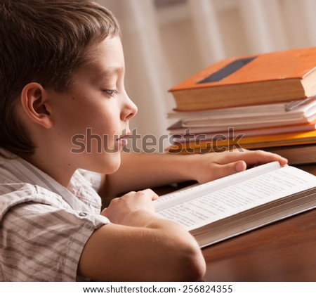 Boy reading book. Child education - stock photo