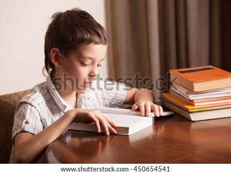 Boy reading book. Child education - stock photo