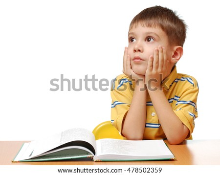 Boy reads book isolated on white background