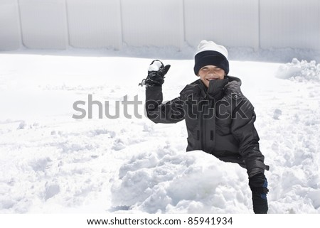 Boy ready for a Snowball Fight - stock photo