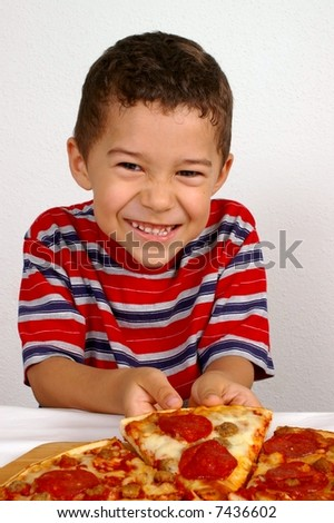 Boy ready to eat a pepperoni pizza - stock photo