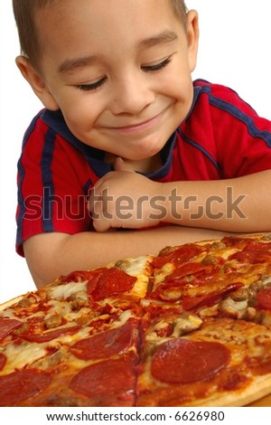 Boy ready to eat a pizza - stock photo