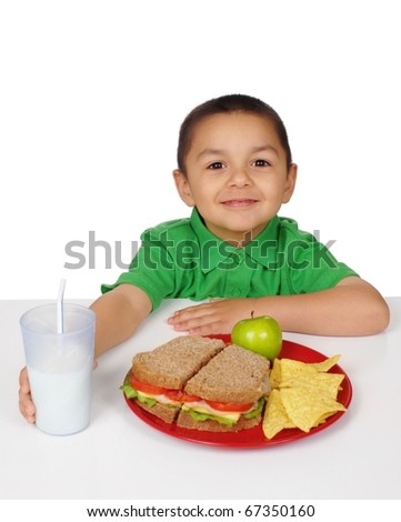 Boy ready to eat a sandwich meal, four years old - stock photo
