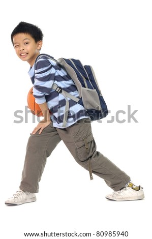 boy ready to school holding a Basketball - stock photo