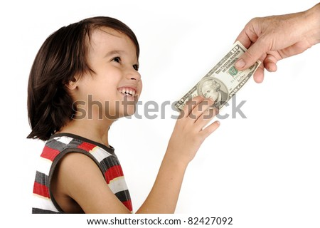 Boy receiving money from adult - stock photo