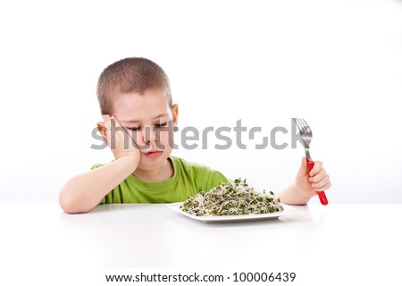 Boy refuses to eating healthy food, isolated on white