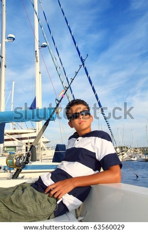 boy relaxed teenager on sea boat marina sunglasses summer vacation - stock photo