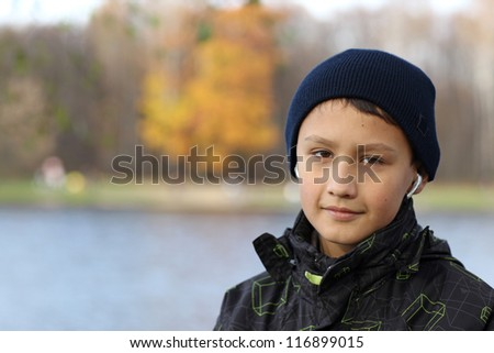 boy relaxing in autumn - stock photo