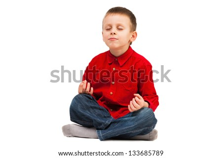 Boy relaxing on a white background