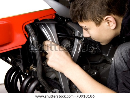 Boy repair motorbike - stock photo