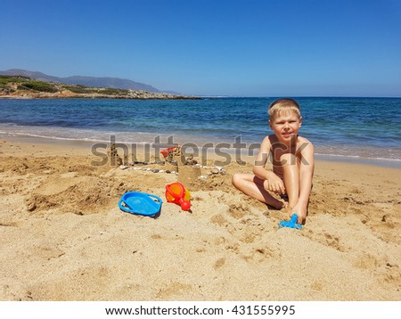 Boy resting and runs along the beach. Children's summer holiday by the sea