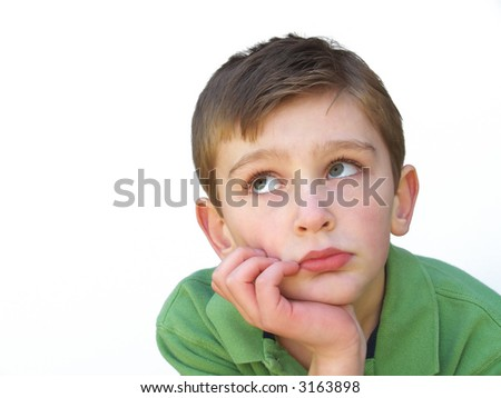 boy resting his face on his hand - stock photo