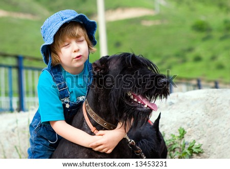 Boy riding by dog  (series Children and Animals) - stock photo