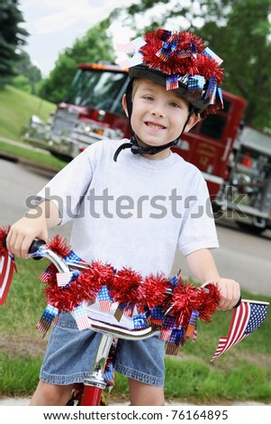 Boy riding his bike in a 4th of July Neighborhood Parade - stock photo