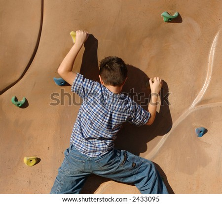 Boy rock climbing. #2 - stock photo
