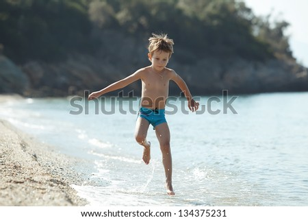 Boy running sea