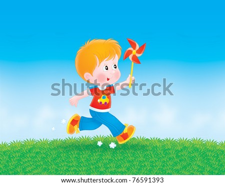 boy running with his color wheel on the grass - stock photo