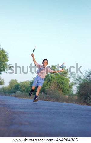 boy running with indian flag in both hand on road