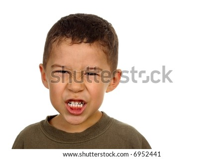Boy's angry expression, with copy space - stock photo