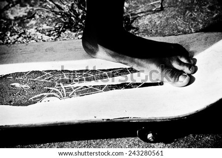 boy's foot on a skateboard - stock photo