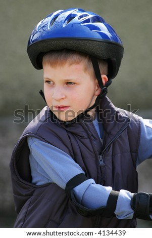 Boy's looking back in blue bikecycle helmet