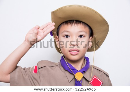 Boy scout, a Thai Asian boy scout in uniform with cheerful on white background - stock photo