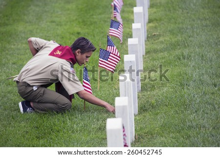 Boy scout places one of 85, 000 US Flags at 2014 Memorial Day Event, Los Angeles National Cemetery, California, USA, 05.24.2014 - stock photo