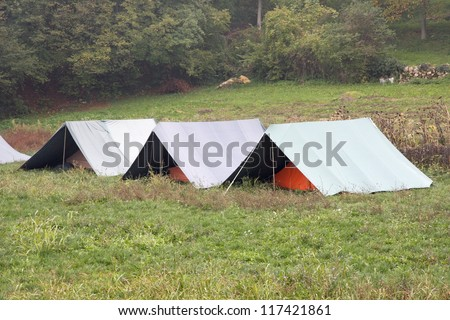 boy scout tents mounted on the grass on a cold winter day - stock photo