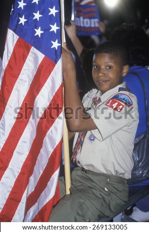 Boy Scout with an American flag at the Clinton/Gore 1992 Buscapade campaign tour in Tyler, Texas
