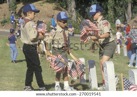 Boy Scouts placing flags at a Veteran's Cemetery, Los Angeles Veterans Cemetery, CA - stock photo